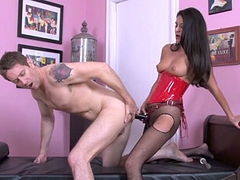 Dark-haired stunner fucks her lover's anus with a strapon
