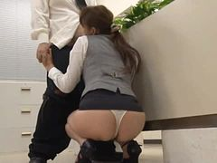Kinky Japanese office girl is giving blow job in meeting place in front of others