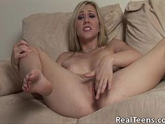 Pretty blonde with a fabulous body playing with her shaved pussy