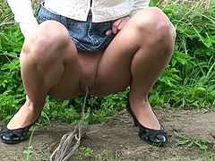 Upskirt and piss play outdoors