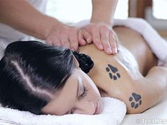 Oiled beauty takes the dick up the pussy during the massage treatment