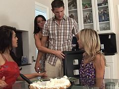 Trio of tanned blonde's take down a lone cock in the kitchen in a foursome scene