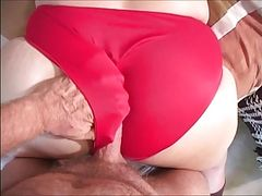 Rubbing against red panties covering a huge butt