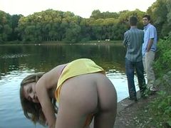 Hot babe Anna demonstrating her sexy pussy in front lake