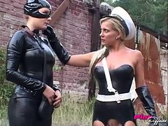 Kinky latex lesbian threesome outdoors with strapon fucking