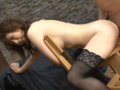 Flirtatious Japanese girl nailed hard in her snatch in a doggy position
