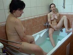 Young and mature lesbians go wild in the bathtub
