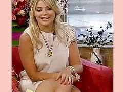 HOLLY WILLOUGHBY FLASHING SOME THIGH