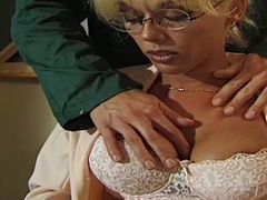 Horny student seduces sexy teacher and fucks her pussy right on the table