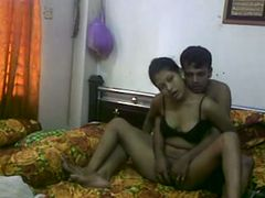 Young and beautiful Bengali wife with her older husband