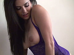 Straight haired brunette hottie Sunny Leone gets rid of lingerie and rubs clit