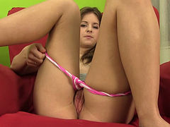 Delightful teen gently rubs her meaty juicy snatch on chair