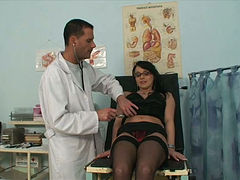 Young kinky doctor licks and fingerfucks wet pussy of his black haired booty chick