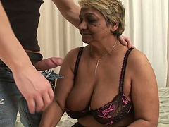 Sex-starved granny rides her lover's cock in reverse cowgirl position