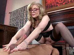 Nina Hartley jerking her lover's hard cock