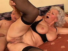 Cougar blonde in stockings gets her hairy pussy spooned from behind