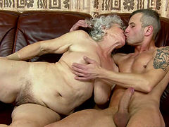 This horny grandma also loves to taste some large cock of strong guys