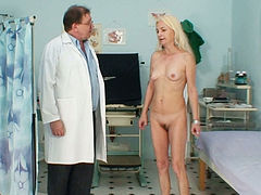 Skinny blondie Vera gets her tits jammed and her pussy examined by kinky doctor