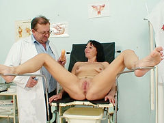 The pussy of slutty Magda gets stretched and filled with some liquid