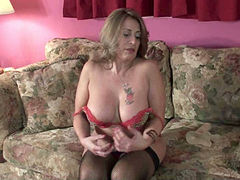 Curvy dark haired MILF in stockings pounds her kitty with big fake cock