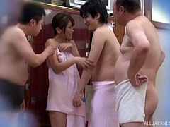 Naked Asian girl joined at the sauna by horny guys