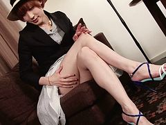Cute and skinny Japanese tranny plays with her sexy cock
