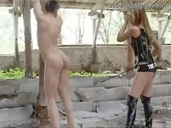 Sexy mistress punishes her slave in the abandoned building