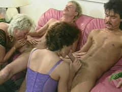 Two old women have fun with horny motherfuckers. Retro