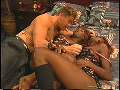 A lucky white guy has a threesome with two ebony babes