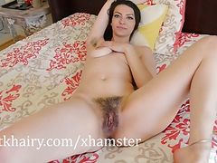 Brunette babe Geneva showing off the pussy hair