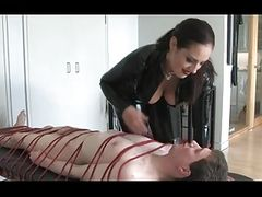 Mistress dominating bound slave and then whipping him