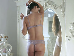 Oversexed angel is masturbating pussy in front of the mirror