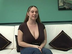 Chubby cougar with massive natural tits playing with a vibrator on her sofa