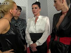 A dominatrix fucks four lesbians with a strapon and shoots jizz on them