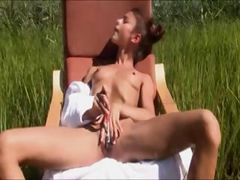 Clit toying with toothbrush in a forest