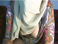 Arab girl displays her breasts