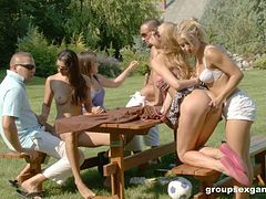 Four chicks and a couple of guy have a wild orgy in the park