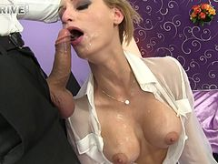 Vivacious blonde with big fake tits sucking a stranger's cock