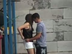 Hidden cam vid with a young couple having oral sex behind a dumpster
