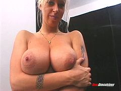 Naturally busty blonde bitch giving a titjob and sucking a cock