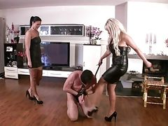 Sadistic FemDom whipping and spittng