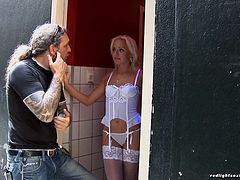 Blonde hooker in lingerie gets filmed while fucking