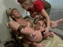 Cruel blond military bitch is conducting some sexual experiments on him