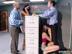 He doesn't seem to mind being caught by the boss, shagging in the office