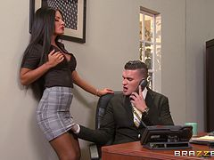 A guy makes a business call while fucking his secretary