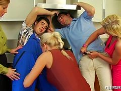 Foursome scene in the kitchen along two blondes being pricked and pissed on