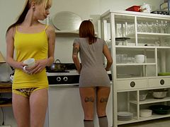 Tattooed lesbians enjoy a face sitting on a kitchen floor