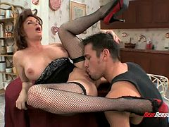 Woman rocking fishnet stockings delights the intense fucking with the jumbo penis