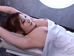 Oiled up Momoka Nishina gets toyed with two dildos