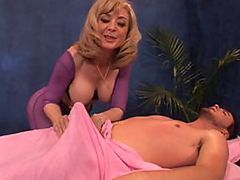 Busty Blonde Mature Nina Hartley Gives Guy a Massage and a Blowjob